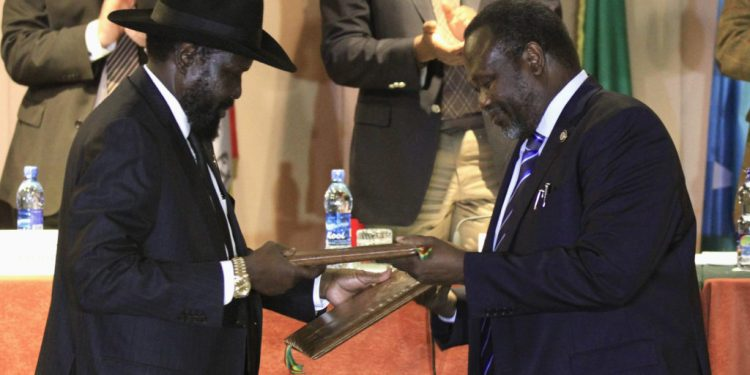 South Sudan's President Kiir and rebel commander Machar exchange documents after signing a ceasefire agreement during the IGAD Summit on the case of South Sudan in Addis Ababa -The Exchange