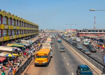Accra, Ghana - July 19, 2010: People walking on the big market in the capital of Ghana, Acrca