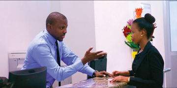 Azania Bank's employee serving customer- The Exchange