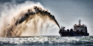 A sand dredger. Sand extraction is fast becoming a transboundary issue due to sand extraction bans, international sourcing of sand for land reclamation projects and impacts of uncontrolled sand extraction beyond national borders. theexchange.africa