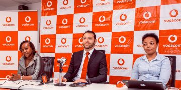 Vodacom Tanzania Managing Director, Hisham Hendi (centre) speaking to the media during a press conference to announce the company's preliminary results- The Exchange