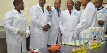 The Chairman of National Standards Council, Mr. Ken Wathome, KEBS Ag. Managing Director, Lt. Col. Bernard Mirani, KEBS Lake Region Manager, Jacqueline Kang'iri, KEBS Head of Testing, Dr. Geoffrey Muriira, during the laboratories tour in the commissioned KEBS Lake Region Headquarter, Kisumu.