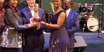 From left Rwanda Minister for Trade and Industry presents the award to TradeMark East Africa's Chief Executive Officer, Frank Matsaert (middle) and TradeMark East Africa-Rwanda Country Director, Patience Mutesi Gatera.