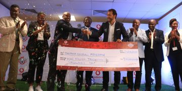 Vodacom Tanzania Plc Managing Director Hisham Hendi,awarding 9 billion sponsorship package to TFF President Wallace Karia