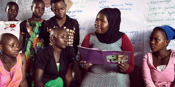 woman reading to the girls- Word Bank Group